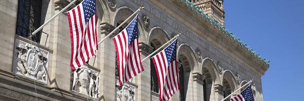 US flags outside Boston Public Library in Boston Massachusetts